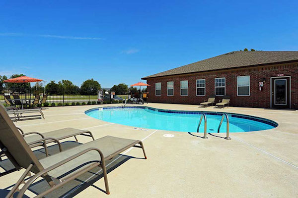 Pool at Pines at Southridge Apartments. In ground with plenty of space to relax in Tahlequah.